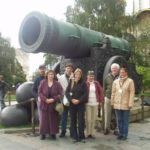 Our group gathers under a cannon