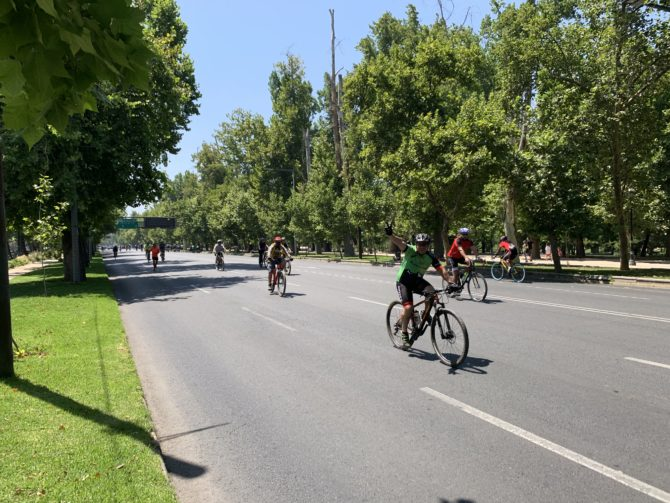 A cyclist enjoys the car-free street