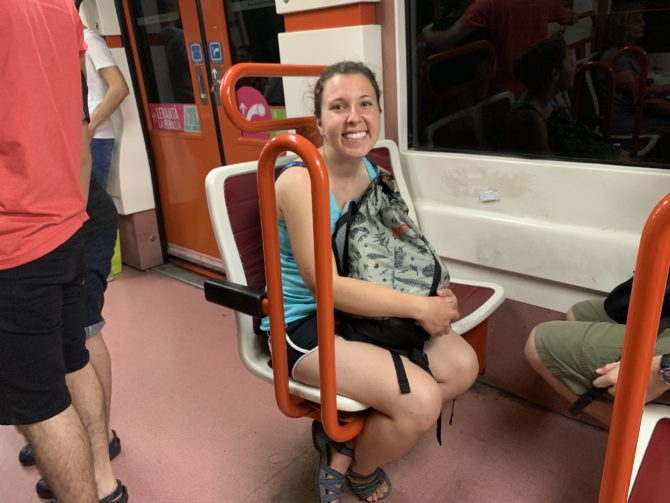 Randi on the Underground. The little clusters of chairs reminded us of a theme-park ride.