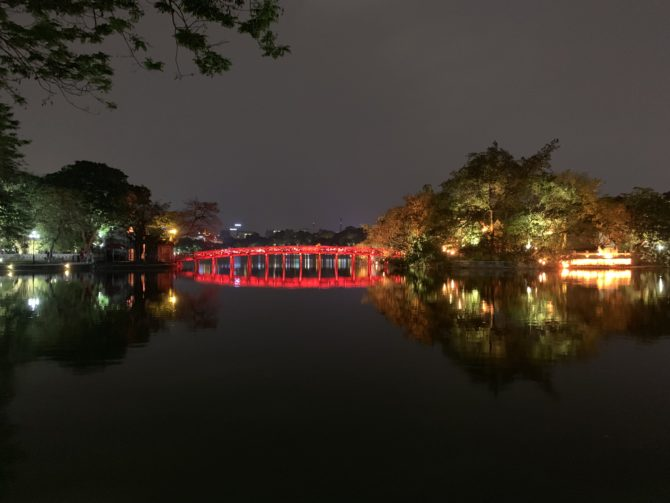 The Huc Bridge in the lake at night